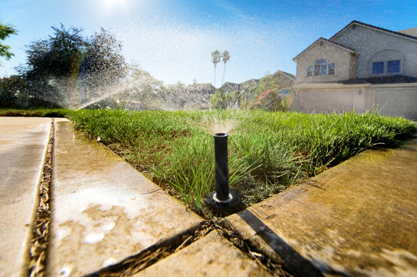 ground view of an automatic lawn sprinkler
