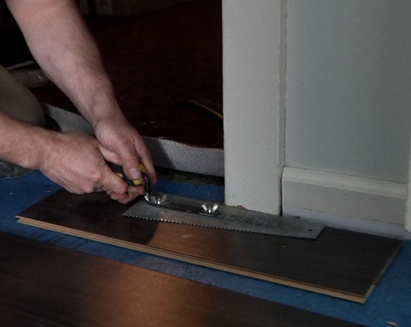 Laminate flooring laminate flooring installation through for Installing laminate wood flooring