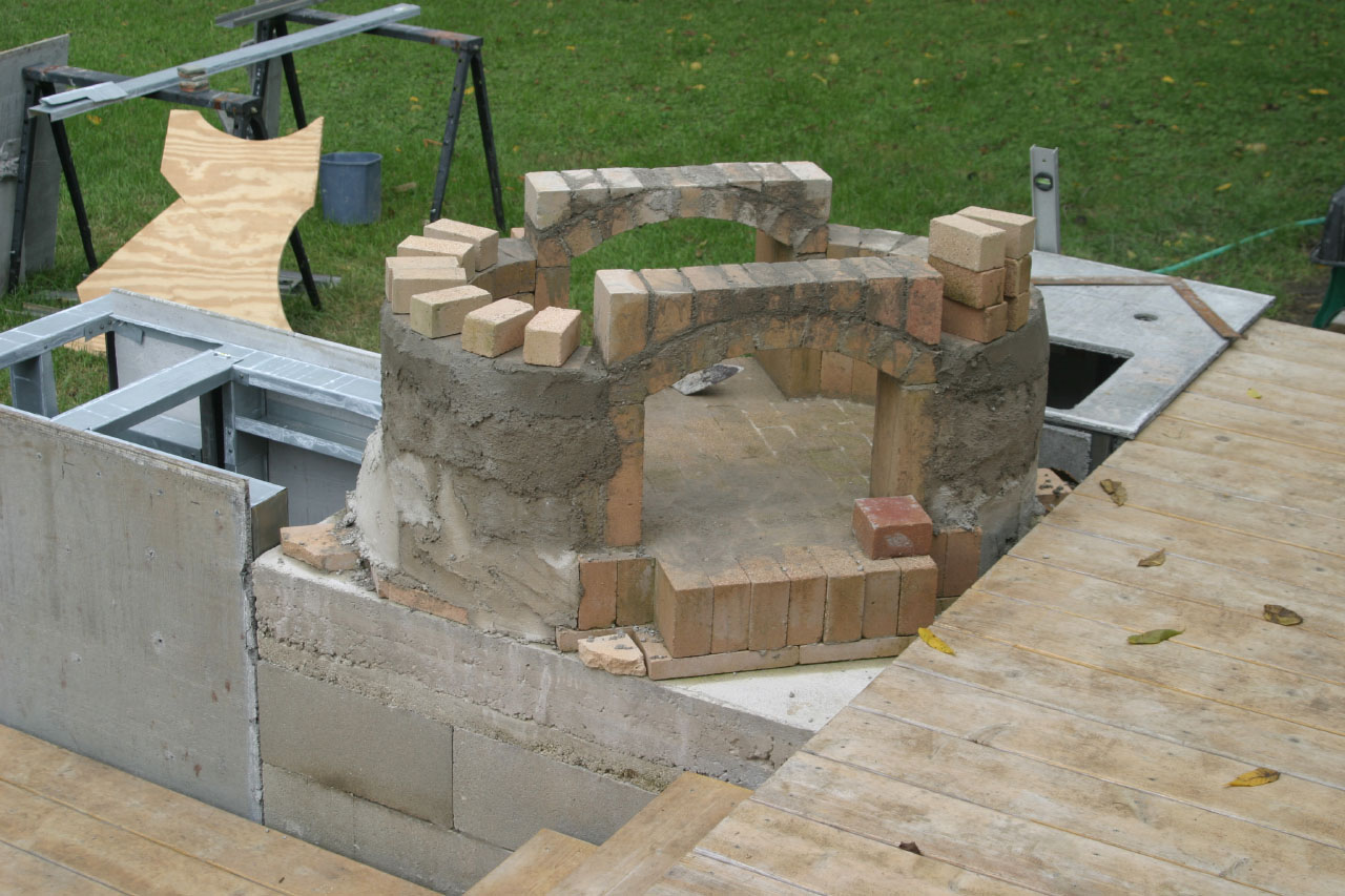 adding concrete to the DIY Brick Bread Oven
