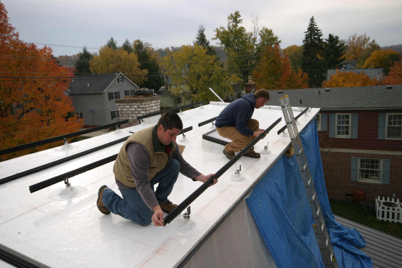 installing the base for a solar panel array on the roof