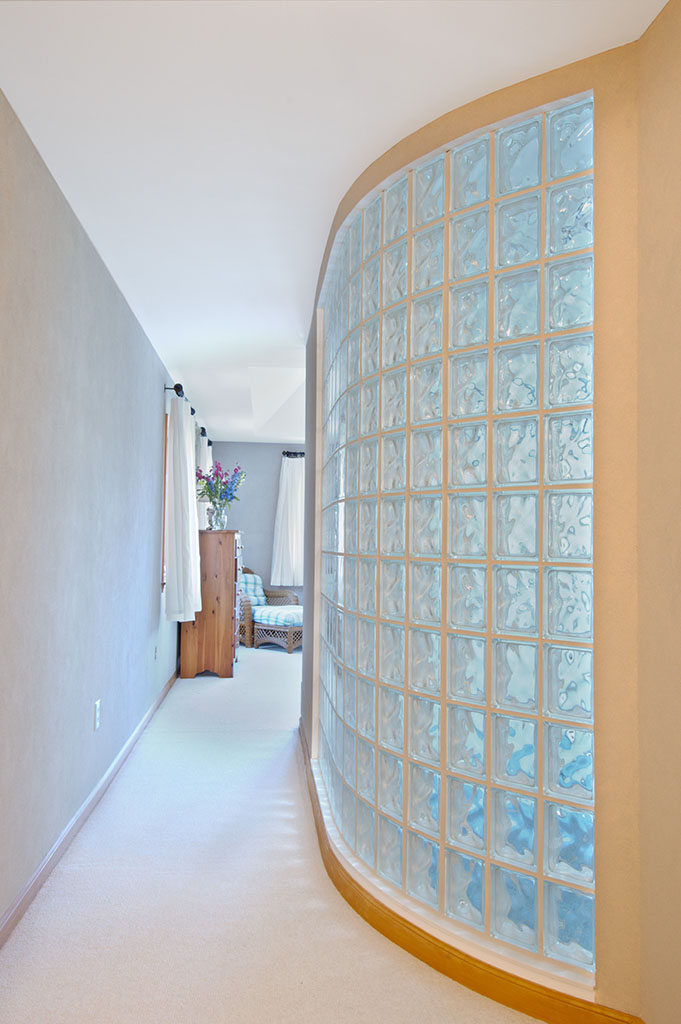 glass block curved wall in bathroom remodel
