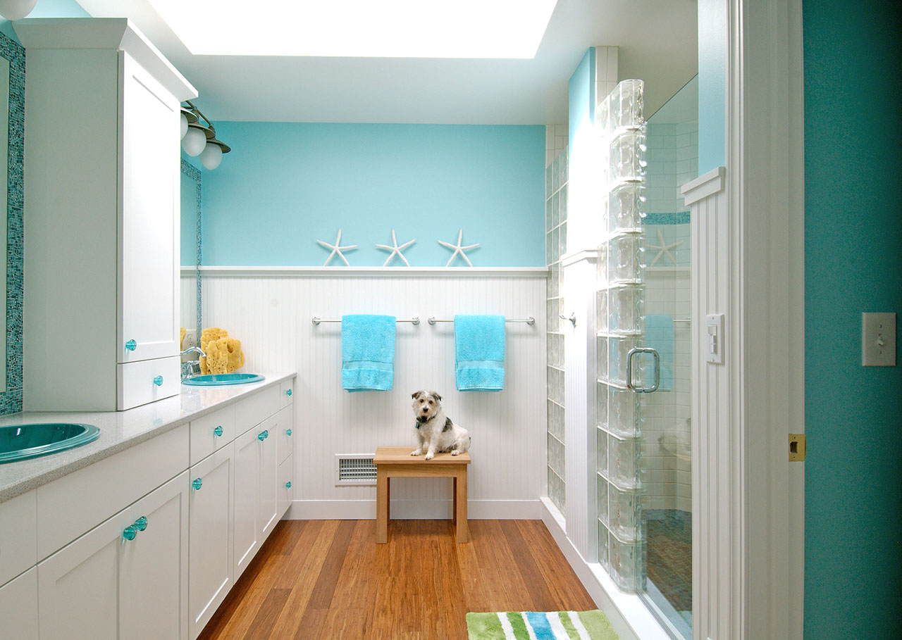 remodeled bathroom in ocean colors with white cabinets