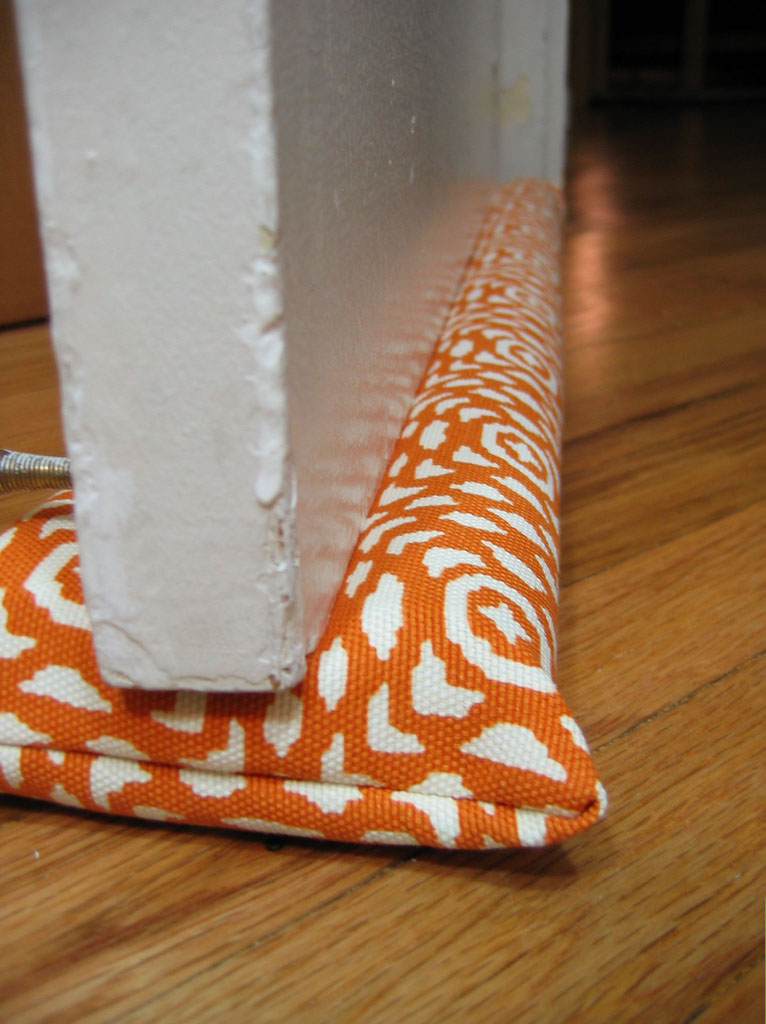 6 simple ways to make your home more energy efficient this for Door draft stopper