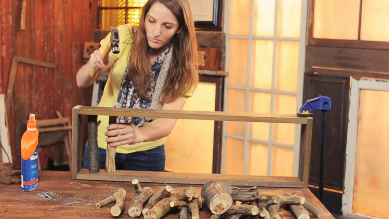 Rachael Ranney assembling an upcycled tree branch coat rack