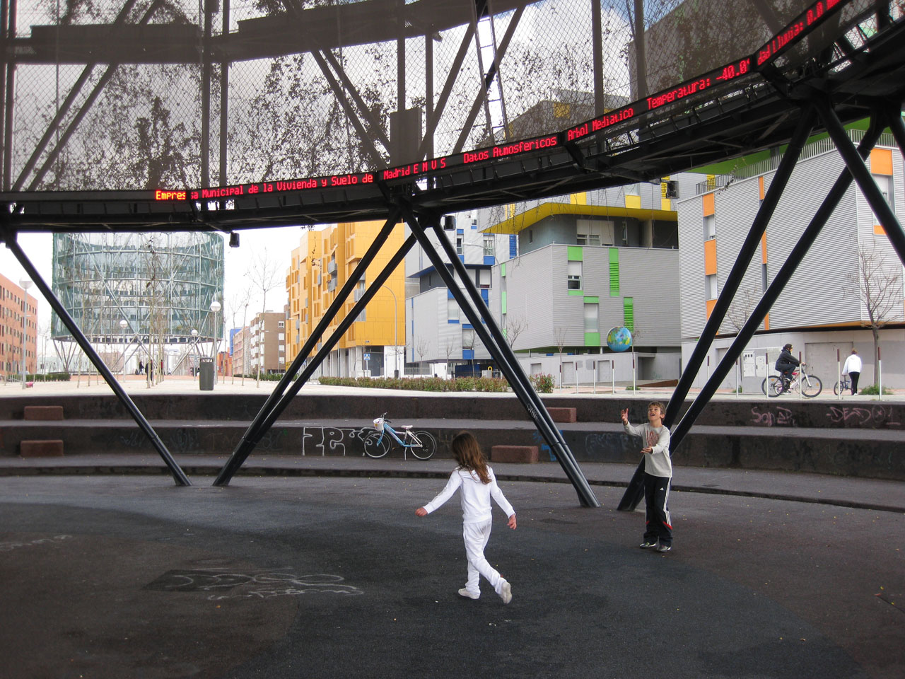 Children playing under Madrid's Eco-boulevard Air Trees by Ecosistema Urbano