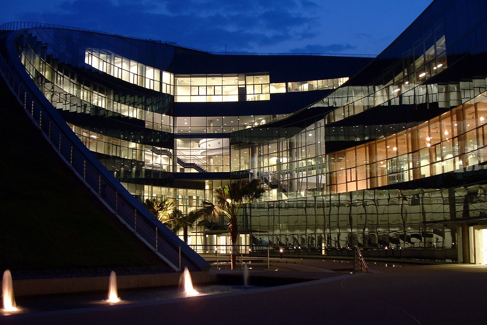 Exterior night view of The Nanyang Technological School of Art, Design, and Media in Singapore by CPG Consultants