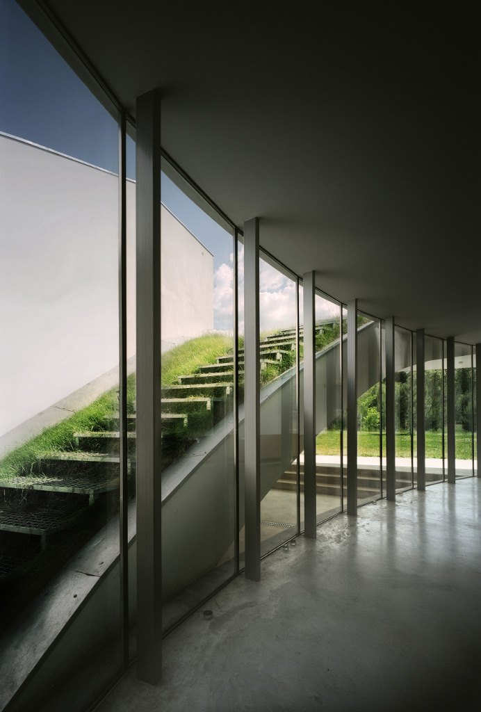 Exterior stairs leading to the green roof of the OUTrial House by Robert Konieczny