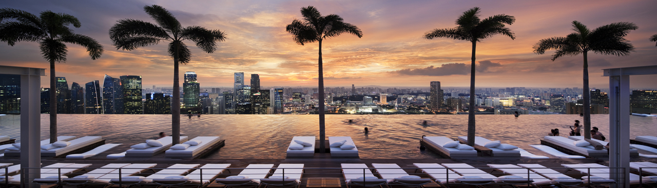 Marina Bay Sands SkyPark's rooftop pool at sunset