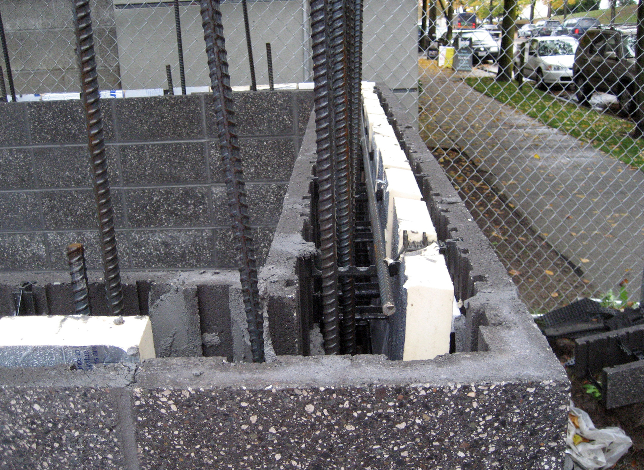 Sustainable concrete form masonry (CMFU) blocks with insulation and rebar