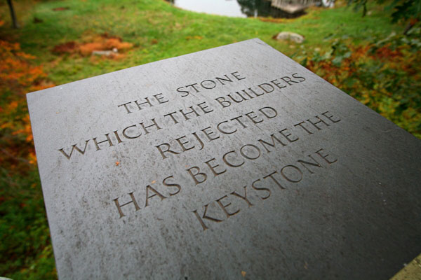 An engraved stone atop the Lincoln Kirstein Tower sculpture at architect Philip Johnson's iconic Glass House estate.