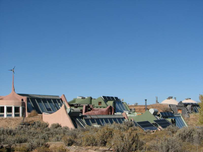Earthship Home by Earthship Biotecture using compressed earth construction