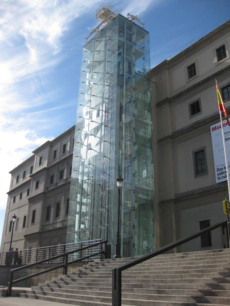 Exterior steel-framed glass elevators of the Reina Sofia Museum in Madrid, Spain