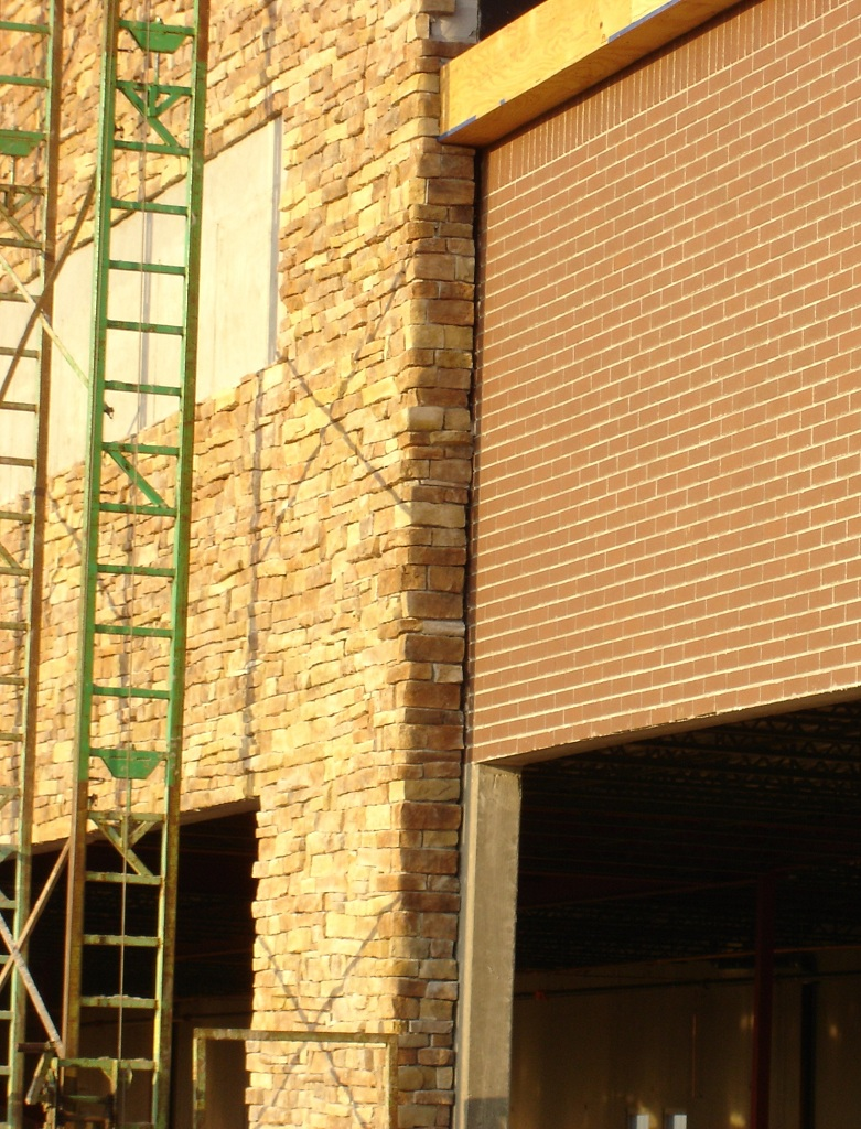 manufactured stone and clay brick construction