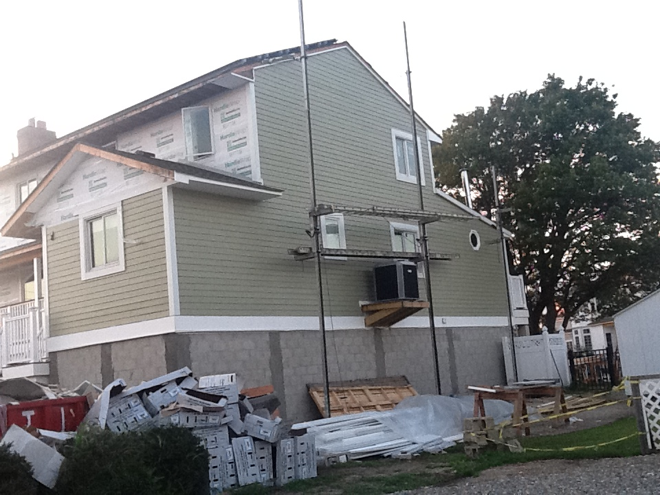 House with weather barrier and fiber cement siding