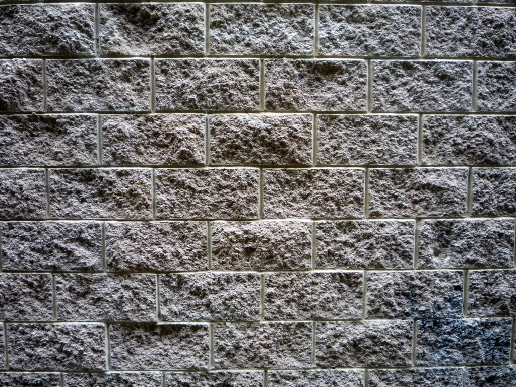 Can you brick veneer retaining wall block home depot for Split face block house