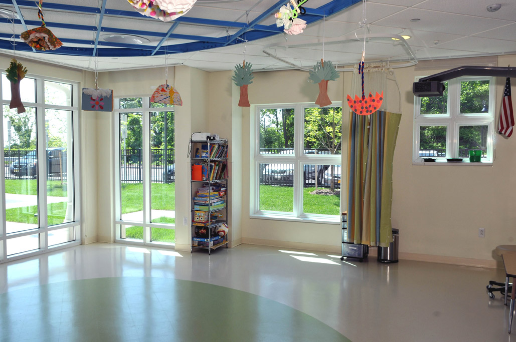 Colorful children's room is flooded with light through Simonton windows.