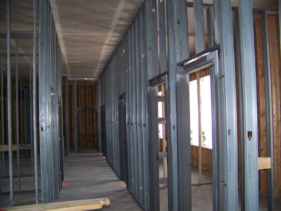 contractor to contractor installing welded hollow metal door frames