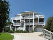 This coastal area home by builder Pat Patteson features Simonton StormBreaker Plus windows.