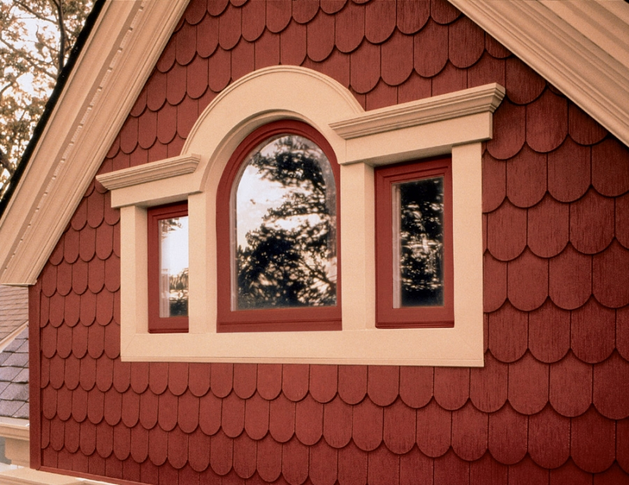Brick colored Decorum by Simonton window frames add color to this home.