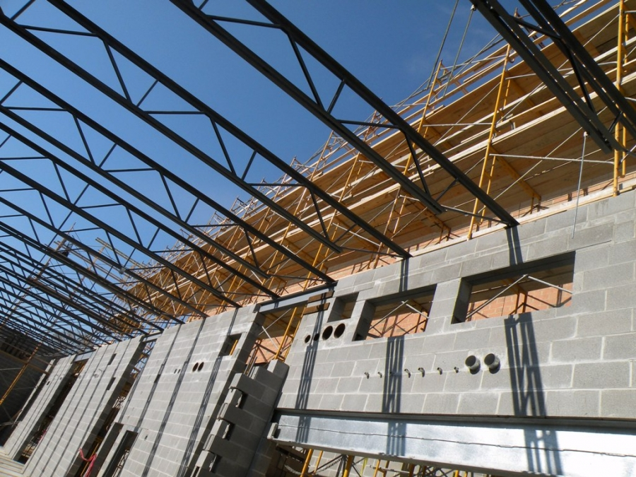 Metal joists buildipedia for Open web trusses