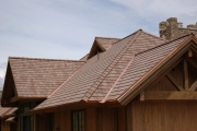 Autumn blend of DaVinci Multi-Width Shake roofing tiles accented by copper valleys.