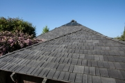 Steep Roof Pitch No Problem for Roofer Installing Polymer Shake Tiles