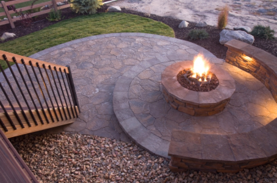 building a fire pit in your backyard is a great weekend project that