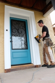 Contractor Mark Clement attaching Fypon decorative trim around his energy-efficient Therma-Tru fiberglass entrydoor.
